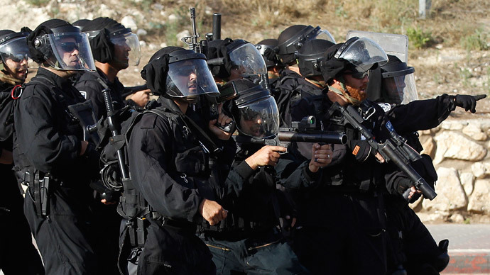 Israeli police take up positions in the Israeli-Arab town of Umm el-Fahm, during a demonstration by protesters against Israel's military operation to search for three missing Israeli teenagers in the occupied West Bank.(Reuters / Ammar Awad )