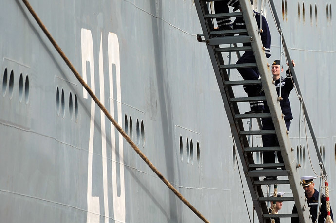 Russian sailors climb stairs of the Smolniy on June 30, 2014 in Saint-Nazaire, western France.(AFP Photo / Jean-Sebastien Evrard)