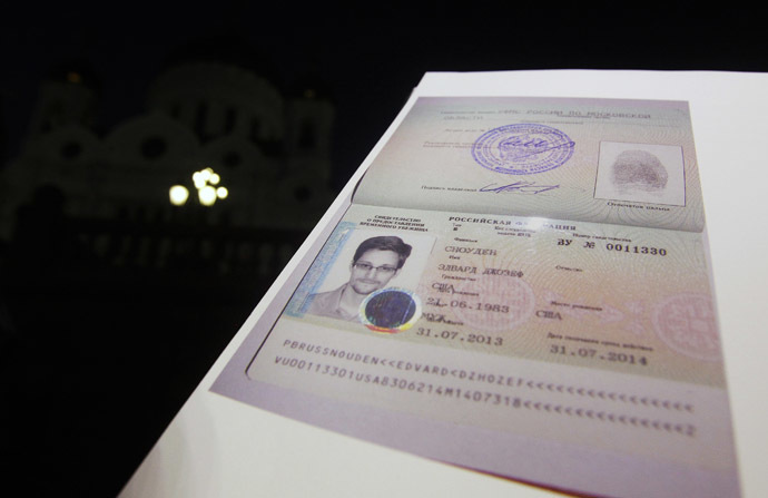 Fugitive former U.S. spy agency contractor Edward Snowden's new refugee documents granted by Russia is seen during a news conference in Moscow August 1, 2013. (Reuters)