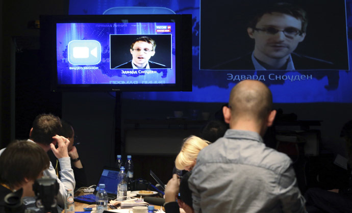 Journalists listen to a speech and a question posed by former U.S. spy agency NSA contractor Edward Snowden, at a media centre during Russian President Vladimir Putin's live broadcast nationwide phone-in, in Moscow April 17, 2014. (Reuters)