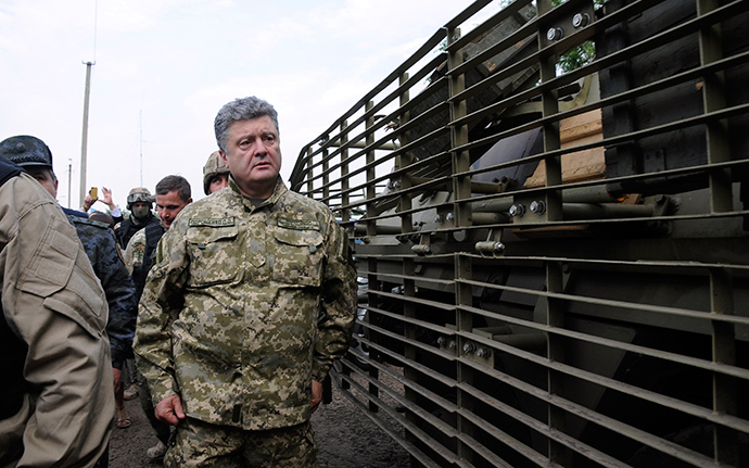 Ukraine's President Petro Poroshenko walks at the military camp near the town of Svyatogorsk in Eastern Ukraine, June 20, 2014 (Reuters / Stringer)