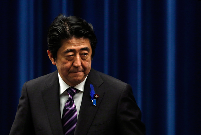 Japan's Prime Minister Shinzo Abe leaves a news conference at his official residence in Tokyo July 1, 2014 (Reuters / Yuya Shino)