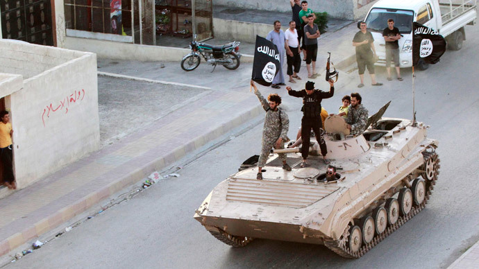 Militant Islamist fighters take part in a military parade along the streets of northern Raqqa province June 30, 2014.(Reuters / Stringer)