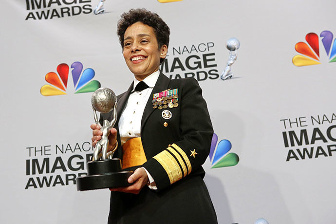 Vice Admiral Michelle Howard poses with her special honors trophy in the press room at the 44th NAACP Image Awards at the Shrine Auditorium in Los Angeles, California, February 1, 2013. (Reuters / Patrick Fallon)