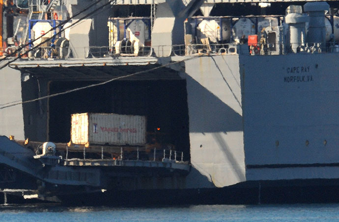 Containers of Syrian chemical weapons from a Danish freighter are transferred to a US military ship ahead of their destruction at sea on July 2, 2014 in the port of Gioia Tauro, southern Italy. (AFP Photo / Mario Laporta)