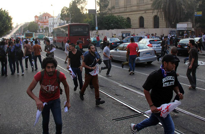 Egyptian demonstrators clash with police following a protest against the demonstration law, near the Presidential Palace in Cairo on June 21, 2014. (AFP Photo / Ahmed Tarana)