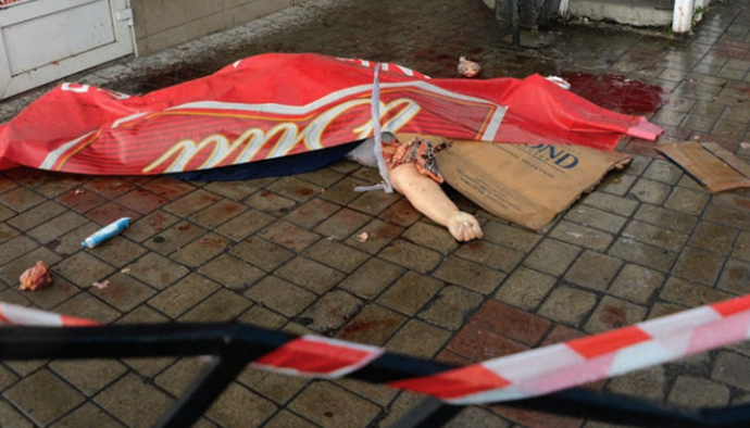 A woman killed during an artillery shelling of the Donetsk railway station (Image from mid.ru)