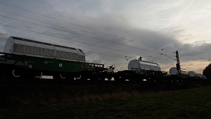 Train transporting CASTOR containers, which carry radioactive nuclear waste, next to a field near Goettingen (Reuters / Alex Domanski)