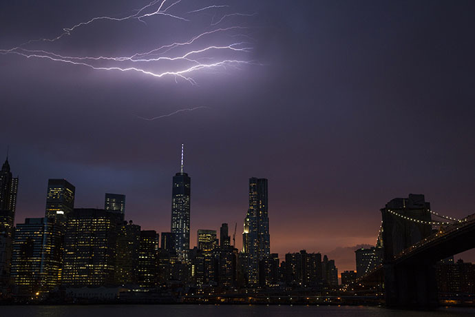 Lightning strikes above the Manhattan skyline during sunset after a summer storm in New York July 2, 2014. (Reuters / Lucas Jackson)