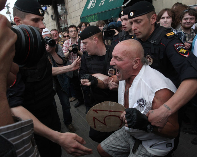 Police detain participants in the Strategy 31 unauthorized rally on Triumfalnaya Square in Moscow. (RIA Novosti/Evgeny Biyatov)