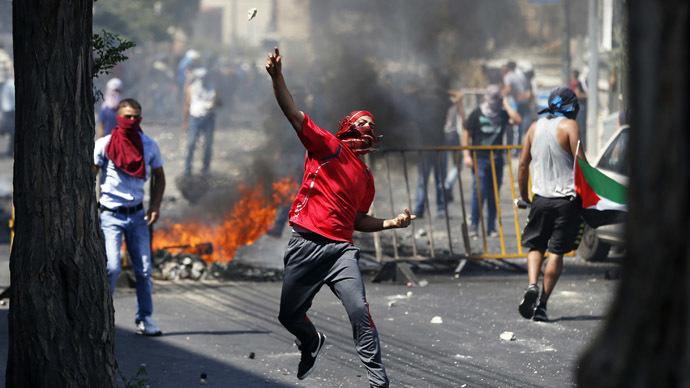 Israeli police, Palestinians clash in Jerusalem as Arab teen's funeral held