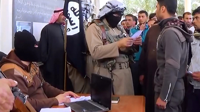 An image grab taken from a propaganda video released on March 17, 2014 by the Islamic State of Iraq and the Levant (ISIL)'s al-Furqan Media allegedly shows ISIL fighters recruiting volunteers at an undisclosed location in the Anbar province (AFP Photo)