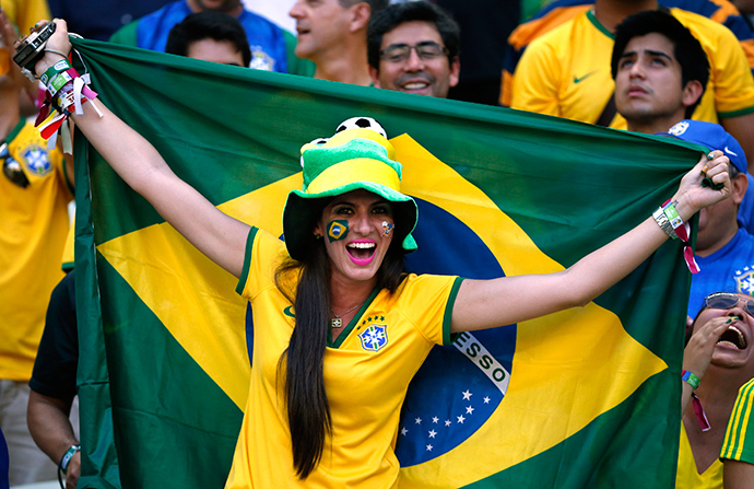 A Brazil fan cheers before the 2014 World Cup quarter-finals between Brazil and Colombia at the Castelao arena in Fortaleza July 4, 2014 (Reuters / Jorge Silva)