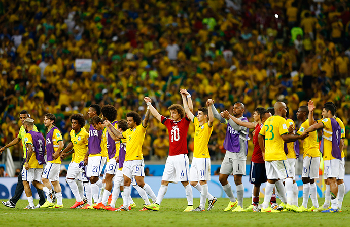Brazil's national soccer players celebrate after the 2014 World Cup quarter-finals between Brazil and Colombia at the Castelao arena in Fortaleza July 4, 2014 (Reuters / Marcelo Del Pozo)