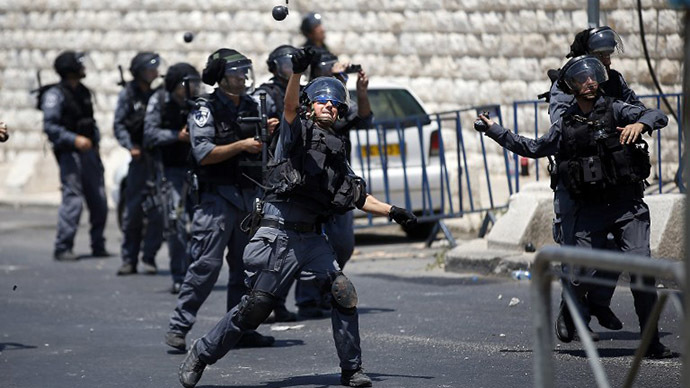 Israeli police throw stun grenades toward Palestinians during clashes after the Friday prayer outside of the Old City in East Jerusalem on July 4, 2014. (AFP Photo / Thomas Coex)