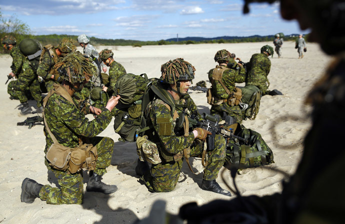 "Troops from Canada's 3rd Division, composed with a platoon of 3rd Battalion and Princess Patricia's Light Infantry, participate at a NATO-led exercise ""Orzel Alert"" held together with the U.S. Army's 173rd Infantry Brigade Combat Team and Poland's 6th Airborne Brigade in Bledowska Desert in Chechlo, near Olkusz, south Poland May 5, 2014. (Reuters/Kacper Pempel)"