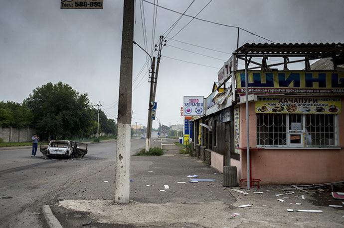 The consequences of an artillery attack on the town of Lugansk. (RIA Novosti / Valeriy Melnikov)