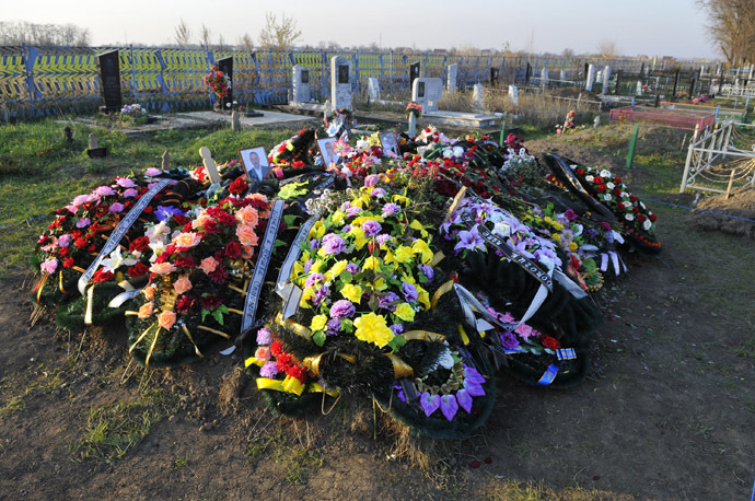 The gravesite of the Ametovs, the host family killed in their home with other two families in the farming village of Kushchevskaya, including the grave of Server Ametov, his wife Galina, daughter-in-law Yelena and granddaughter Amira, at the village's burial ground. (RIA Novosti)