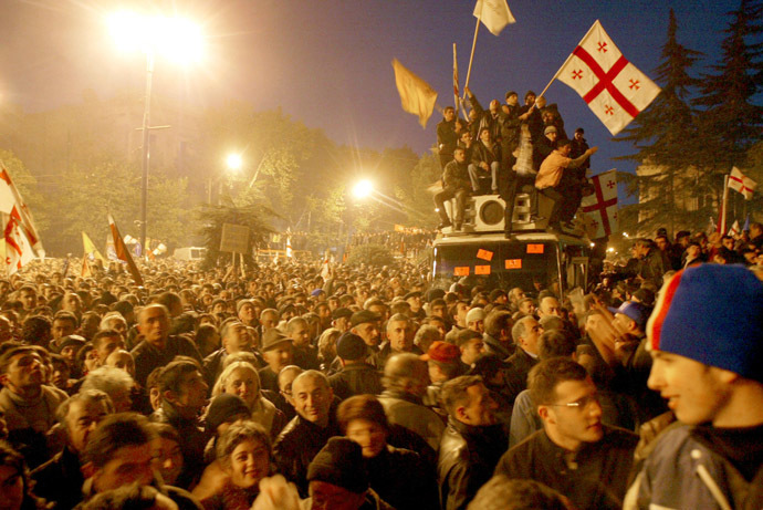 Georgian opposition supporters wave national flags as they celebrate outside the Georgian parliament in Tbilisi, November 22, 2003. (Reuters/Gleb Garanich)