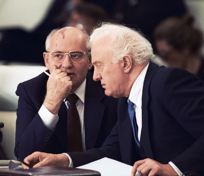 November 21, 1990. U.S.S.R. President Mikhail Gorbachev (left) talking with U.S.S.R. Foreign Minister Eduard Shevardnadze (right) at the first plenary sitting of an all-European top-level meeting.