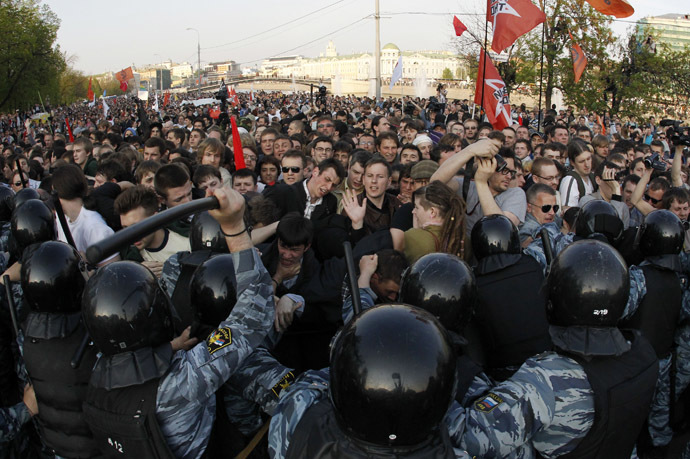 "Russian riot police scuffle with protestors during the ""march of the million"" opposition protest in central Moscow May 6, 2012. (Reuters/Mikhail Voskresensky)"