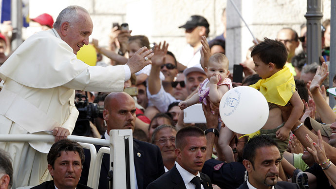 Pope Francis waves as he arrives to lead a prayer in Isernia, south of Italy, July 5, 2014. (Reuters/Ciro De Luca)