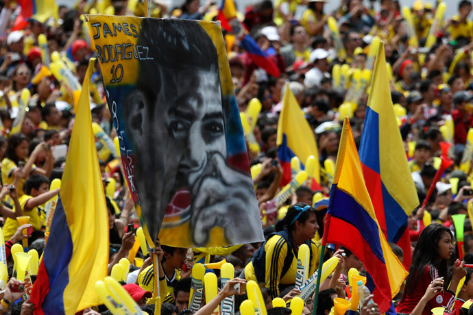 A Colombian fan holds a banner of James Rodriguez while waiting with other fans for the arrival of Colombia's national soccer team at Bolivar park in Bogota July 6, 2014.(Reuters / John Vizcaino)