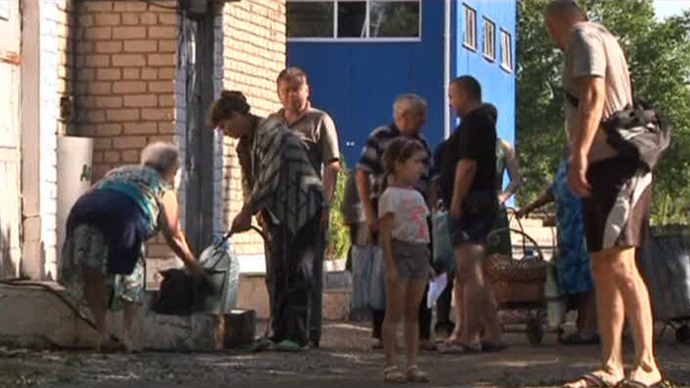 local residents in Lugansk (screenshot from RT)