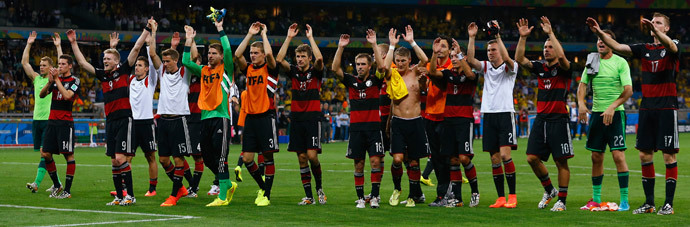 Germany's national soccer players raise their arms in celebration of their win over Brazil at the end of their 2014 World Cup semi-finals at the Mineirao stadium in Belo Horizonte July 8, 2014.(Reuters / Damir Sagolj)