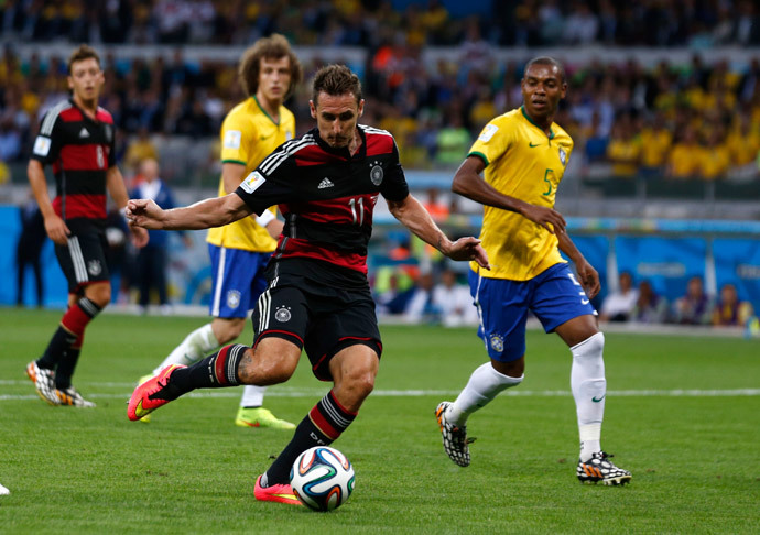 Germany's Miroslav Klose scores a goal during the 2014 World Cup semi-finals between Brazil and Germany at the Mineirao stadium in Belo Horizonte July 8, 2014.(Reuters / Marcos Brindicci)