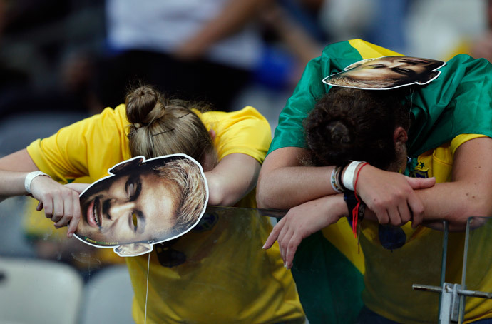 Fans of Brazil react after their loss to Germany in their 2014 World Cup semi-finals at the Mineirao stadium in Belo Horizonte July 8, 2014.(Reuters / Marcos Brindicci)