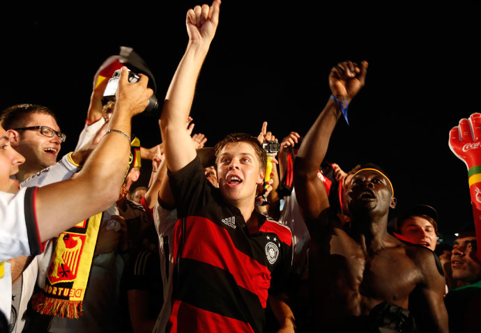 German soccer fans celebrate after watching a broadcast of the 2014 World Cup semi-final between Brazil and Germany at Copacabana beach in Rio de Janeiro, July 8, 2014.(Reuters / Pilar Olivares)