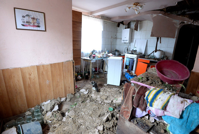 A house in the residential settlement Bolshaya Vergunka, on the outskirts of Lugansk, ruined by an artillery shelling of the Ukrainian army. (RIA Novosti/Mikhail Voskresenskiy)