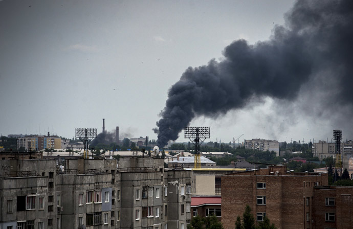 The town of Lugansk during an artillery attack. (RIA Novosti/Valeriy Melnikov)