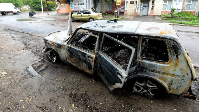A car burnt during an artillery shelling of the Ukrainian army. (RIA Novosti/Mikhail Voskresenskiy)