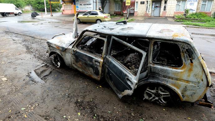 A car burnt during an artillery shelling of the Ukrainian army. (RIA Novosti/Mikhail Voskresenskiy)