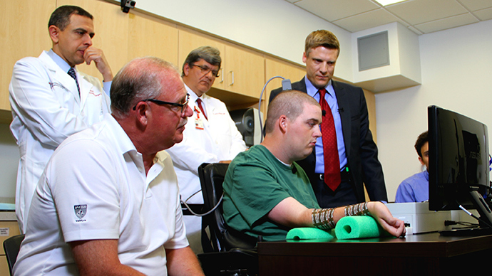 First time ever: Paralyzed man moves hand with thoughts using bionic tech (VIDEO)