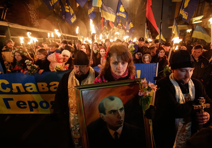 Activists of the Svoboda (Freedom) Ukrainian nationalist party hold torches as they take part in a rally to mark the 105th year since the birth of Stepan Bandera, one of the founders of the Organization of Ukrainian Nationalists (OUN), in Kiev January 1, 2014.(Reuters / Maxim Zmeyev)