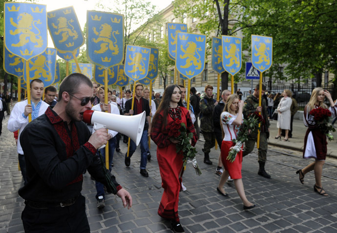 "Ukrainian ultra-nationalists they march in the center of the western city of Lvov on April 27, 2014 to mark the 71st anniversary of 14th SS-Volunteer Division ""Galician"" foundation. (AFP Photo / Yuriy Dyachyshyn)"