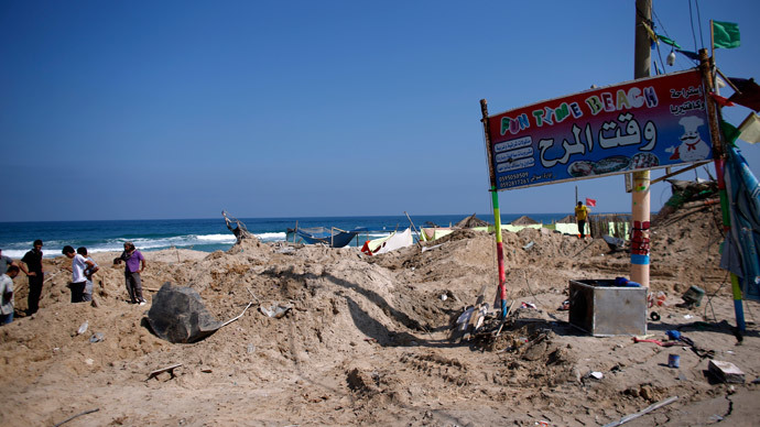 Palestinians search for bodies at a beach cafe hit the previous night by an Israeli air strike while people were watching the World Cup semi-final football match, on July 10, 2014 in the southern Gaza Strip city of Khan Yunis. (AFP Photo / Thomas Coex)