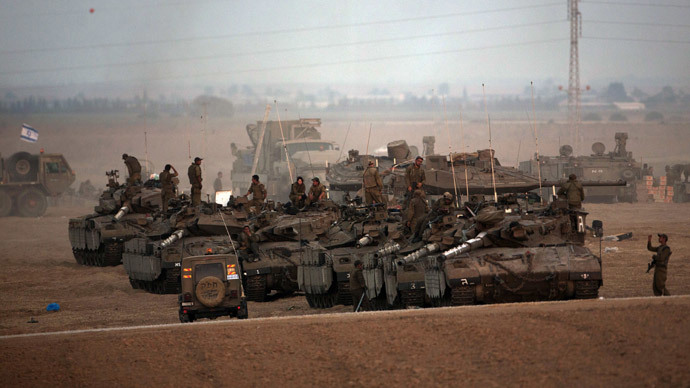 Israeli soldiers gather in an army deployment area near Israel's border with the Gaza Strip on July 10, 2014.(AFP Photo / Menahem Kahana )