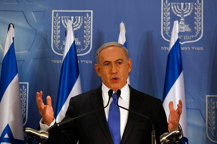 Israeli Prime Minister Benjamin Netanyahu gestures as he speaks during a press conference at the defense ministry in the Israeli coastal city of Tel Aviv on July 11, 2014. (AFP Photo / Gali Tibbon)