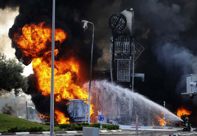 Israeli firefighters extinguish a fire that broke out after a rocket hit a petrol station in the southern Israeli city of Ashdod July 11, 2014. (Reuters/Avi Roccah)