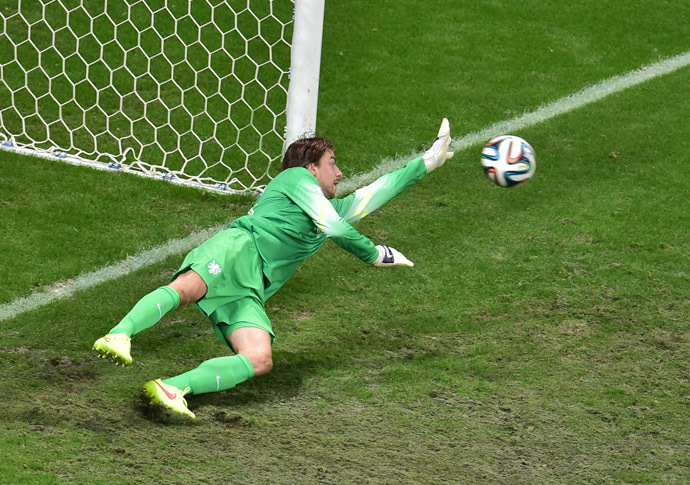 Netherlands' goalkeeper Tim Krul saves a penalty by Costa Rica's defender Michael Umana (not pictured) during the penalty shout out of a quarter-final football match between Netherlands and Costa Rica at the Fonte Nova Arena in Salvador during the 2014 FIFA World Cup on July 5, 2014. (AFP Photo/Gabriel Bouys)