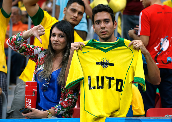 "Fans hold up a Brazil jersey reading, ""Mourn"" during the 2014 World Cup third-place playoff between Brazil and the Netherlands at the Brasilia national stadium in Brasilia July 12, 2014. (Reuters / Jorge Silva)"