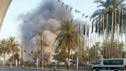 Over 50 dead in Tripoli airport battle as foreigners leave collapsing Libya