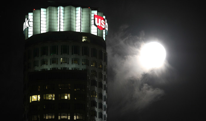 The so-called Supermoon, or perigee moon, rises behind a cloud near the landmark 73-story tall U.S. Bank Tower on July 12, 2014 in Los Angeles, California. (David McNew/Getty Images/AFP)