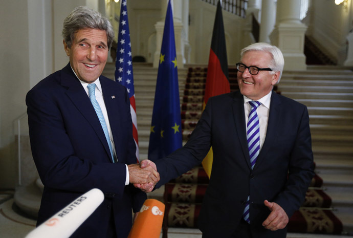 U.S. Secretary of State John Kerry (L) and German Foreign Minister Frank-Walter Steinmeier shake hands as they conclude remarks to the media, after talks between the foreign ministers of the six powers negotiating with Tehran on its nuclear program, in Vienna July 13, 2014. (Reuters/Jim Bourg)