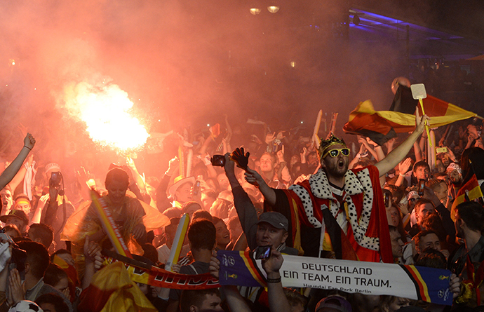 Fans of Germany celebrate as they watch the 2014 World Cup final between Germany and Argentina in Brazil at a public screening of the match in Berlin July 13, 2014. (Reuters / Fabian Bimmer)