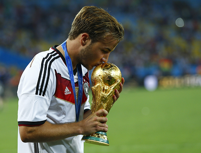 Germany's Mario Goetze kisses the World Cup trophy after the 2014 World Cup final against Argentina at the Maracana stadium in Rio de Janeiro July 13, 2014. (Reuters / Eddie Keogh)
